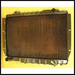 Omix-ADA Radiator 2-Core For 1981-86 Jeep CJ Series With 6 CYL Drivers Side Offset Cap 17101.10